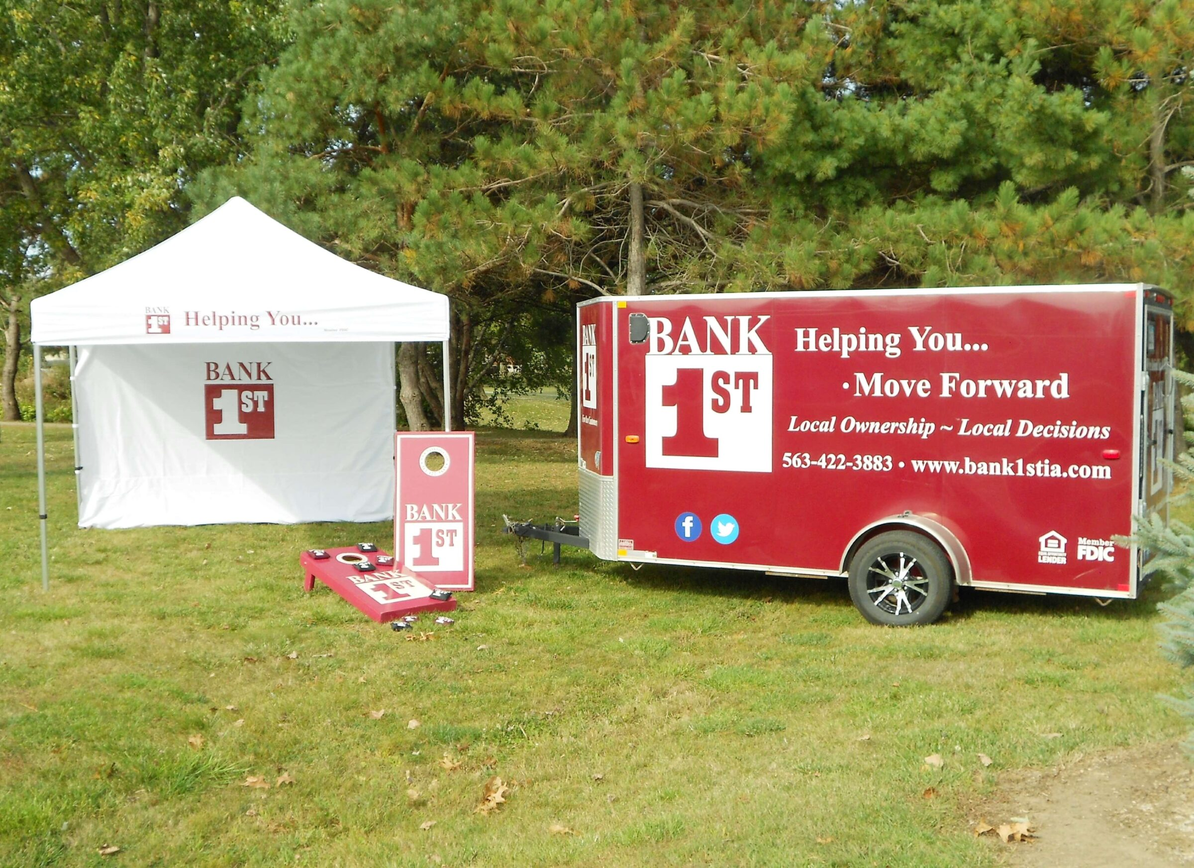 Bank 1st trailer, tent and bean bag boards
